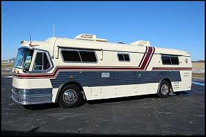 Click image for larger version  Name:1967 Custom Coach Champion Land Cruiser Driver Side View.jpg Views:102 Size:27.1 KB ID:4510